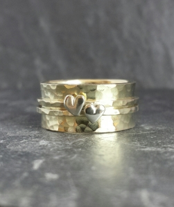 10mm wide 9ct main band adorned by ...skinny static 9ct yellow bands with 9ct white hearts ...